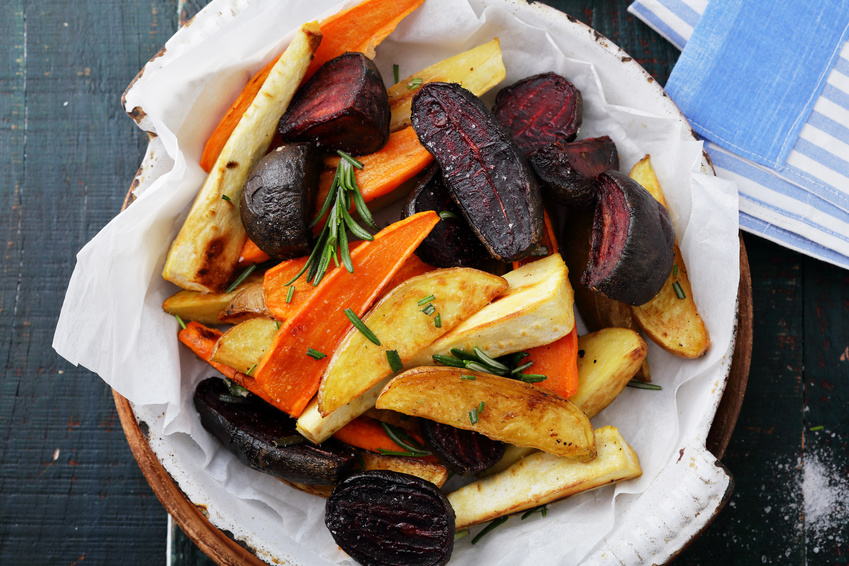 baked carrots and beets with herbs, food top view